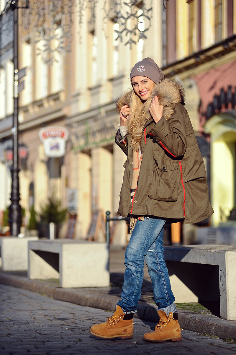 Here's an example of a work boot actually going to work – we think, at least. In any event, this outfit worn by Ines (the youngest of three Polish sisters who run the uber-trendy blog, Sin by Mannei) is warmly comfy, with a statement Burberry scarf that brings everything together.
