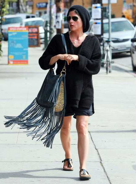 Actress Selma Blair pairs her black Birkenstock Gizeh sandals with an over-sized smock and decadent fringe bag, which is also very hot this season!